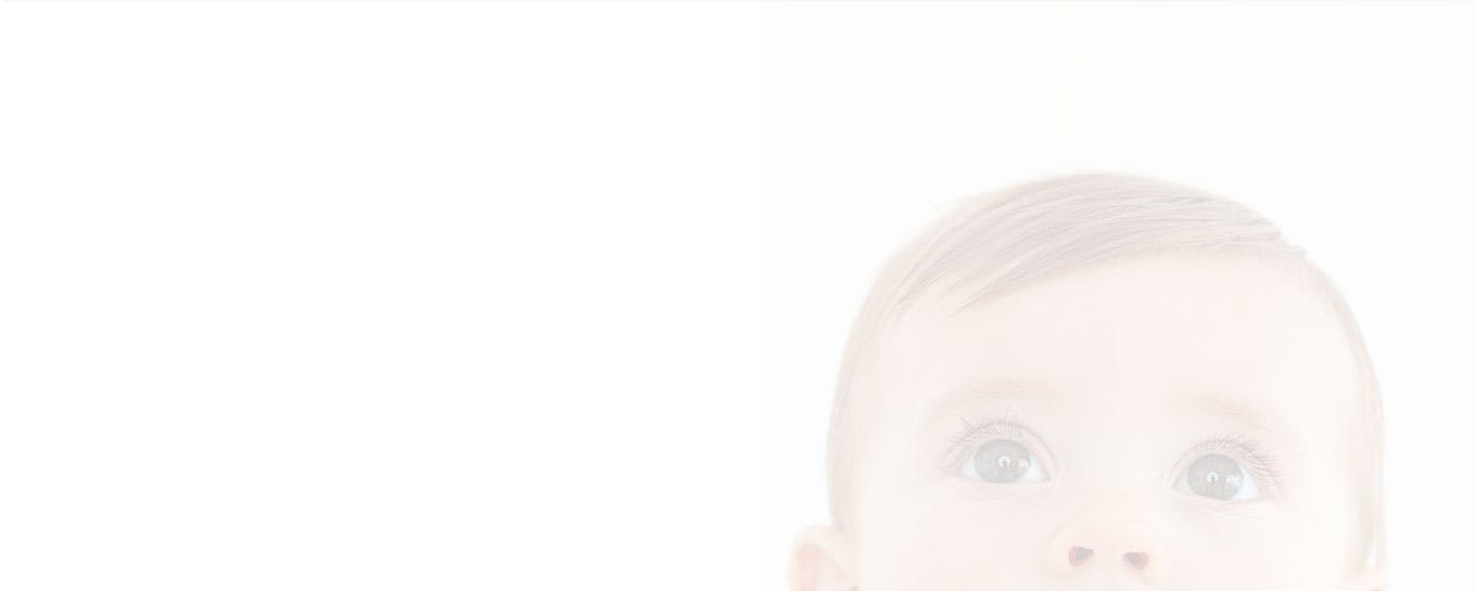 header - close up of babies head with eyes looking up